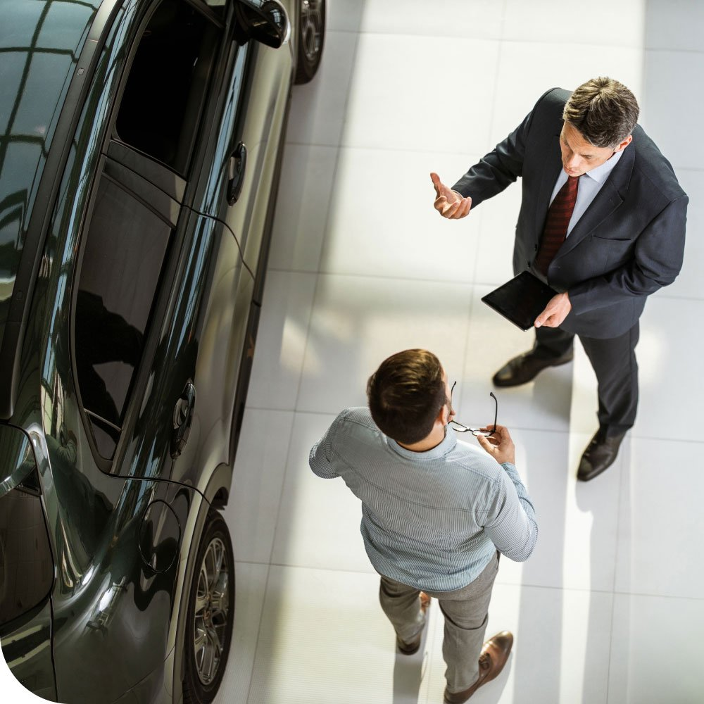 Car sales manager talking to customer