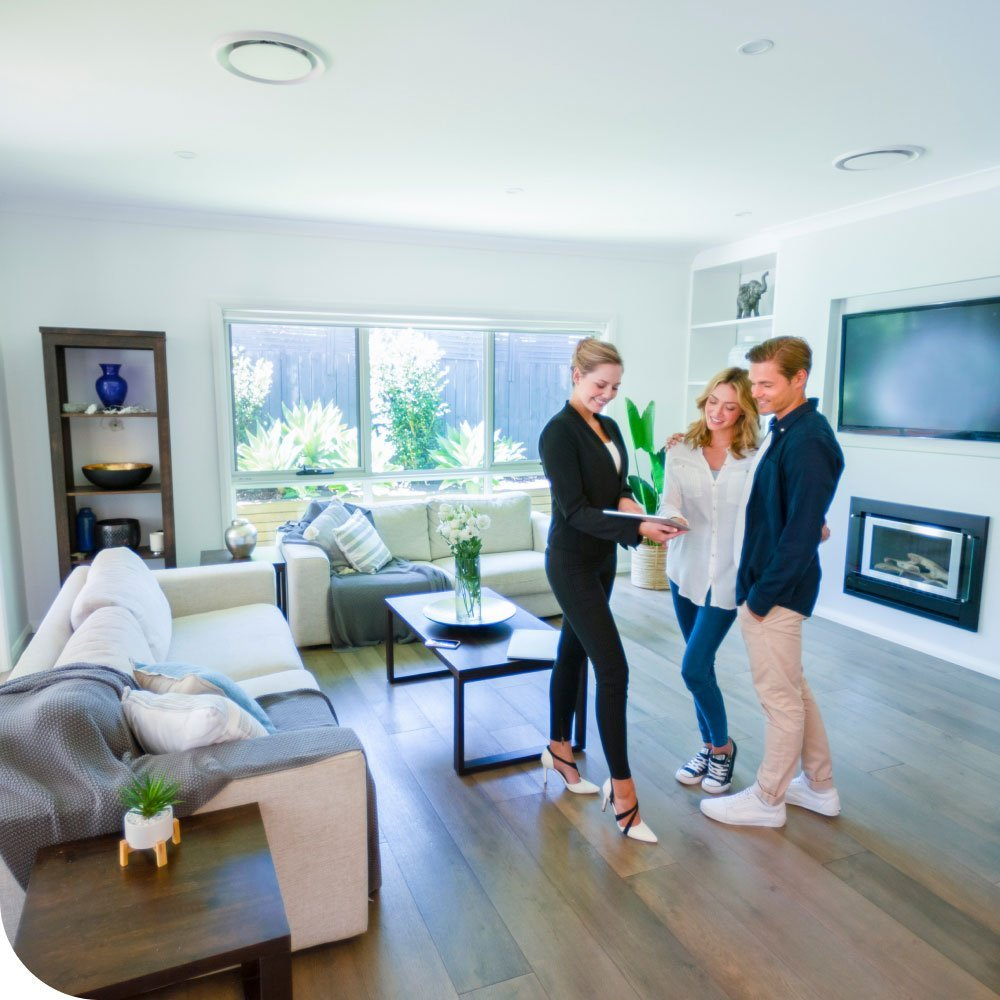 Couple viewing new build show home